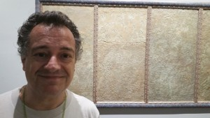 Artist, actor and poet Philip Cairns in front of Annie's artwork