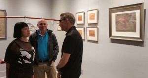 Gallery curator Allen Shugar (R) talks with Annie's fans/collectors