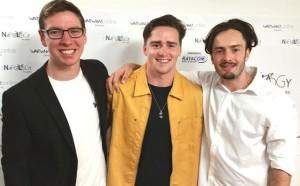 Caleb (R) with crew members