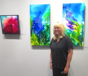 Michelle Hudson with her artworks