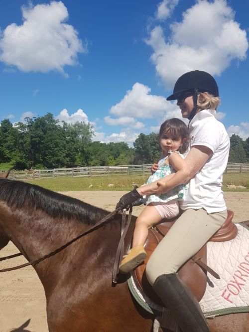 Riding horse Prospero with grand-daughter Willow